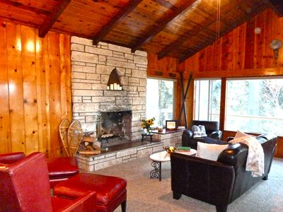 Vintage knotty pine great room for relaxing near the fire in a tranquil setting.
