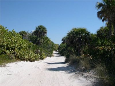 Stroll to the beach just down the road or take the golf cart!
