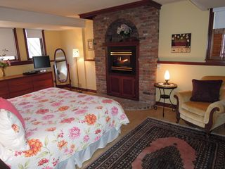 Niagara-on-the-Lake house photo - Large Master bedroom with King bed, gas fireplace and en suite bath