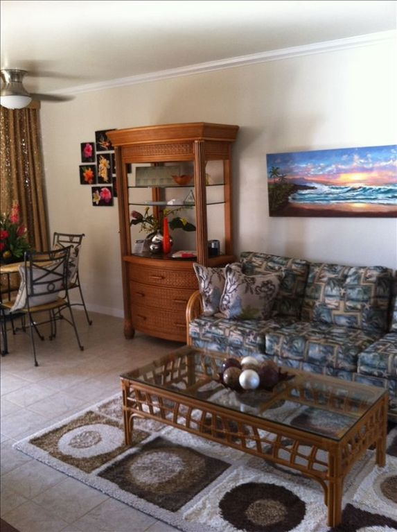 Spacious living area with accented with local art and personal touches.