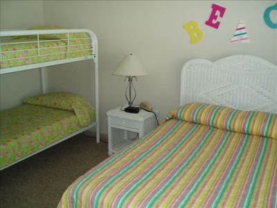 Double bed with set of bunks, there is an adjoining bath.