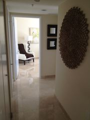 Sunny Isle apartment photo - Hallway To Washer/Dryer, Bathroom 2, Bedroom 2 and Bedroom 3.