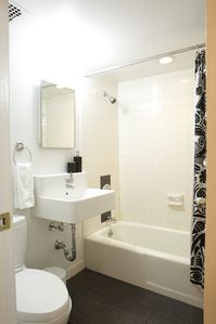 Bathroom with shower curtain open