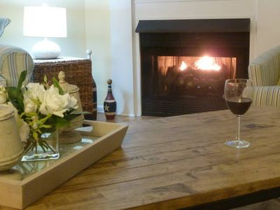 Enjoy a glass of wine by the fire, enjoying views of the bay cozy inside