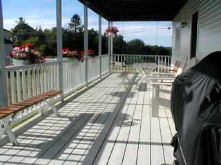 Deer Isle house photo - Here's the large, covered lower deck with gas grill, picnic table and swing.