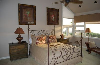 A beautifully furnished guest bedroom.