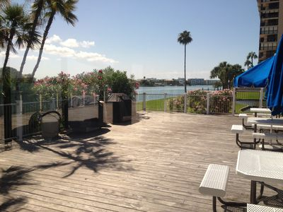 Spacious deck on the water w/ professional grills & seating for family & friends