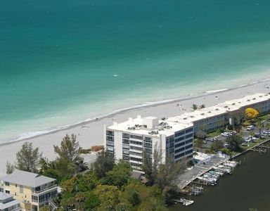 Aerial view of Dockside/ Bay in Back and full Gulf in front