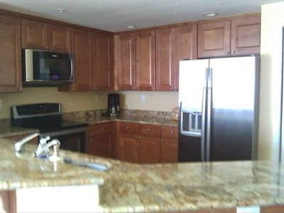 Stain-less steel premium appliances; granite counters...