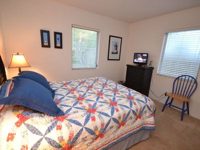 Master bedroom with queen size bed & LCD TV