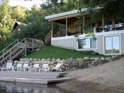 View of porch and waterfront with private beach and dock.