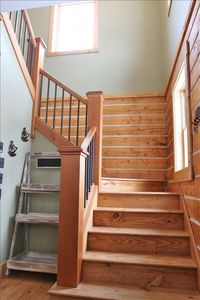 Beautiful staircase leading to second floor with views of Mt. Crested Butte