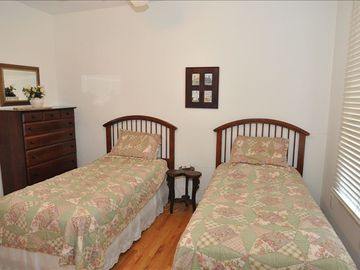 two twin beds and jack/jill bathroom attached