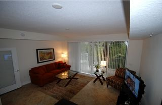 Tampa townhome photo - Large living room w. LCD-TV, DVD,CD,W-LAN, Play station.balcony & view of Marina