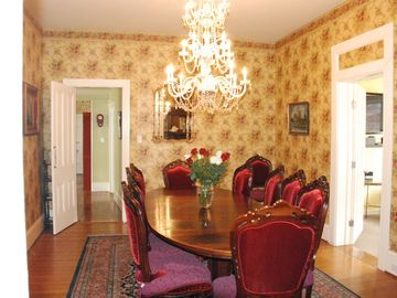 Large formal dining room with crystal chandelier. Dining table seats 10 - 12.
