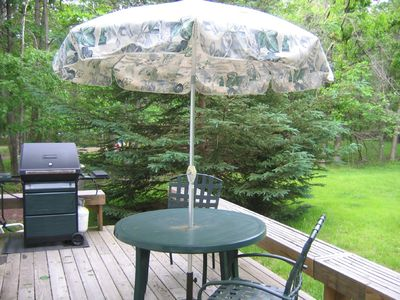 Deck with chairs, grill. Enjoy our large, flat, private back yard