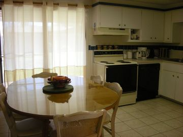 Dining with fully equipped kitchen