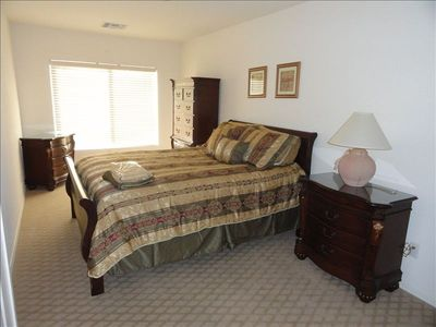 Third bedroom with closet and pillowtop queen bed.