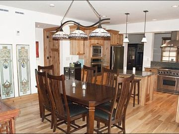 Formal Dining Area off the Kitchen with Room for 10