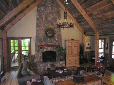 Great Room with 100 year old barn wood and hand hewn beams