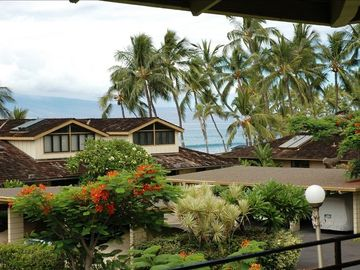2nd story lanai with tree top & ocean view