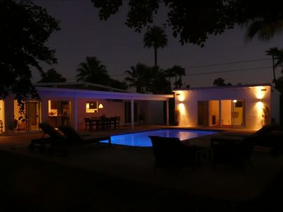 Amazing evening lighting: indigo pool with dramatic landscape lighting.