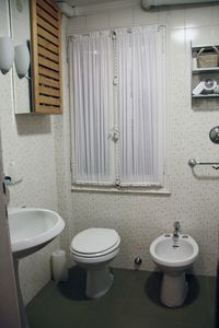 Bathroom with basin, WC, bidet, cabin shower and washing machine