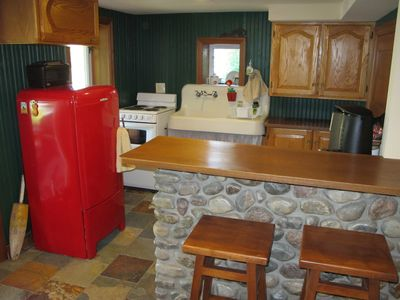 Kitchen with vintage farmhouse sink and fridge.