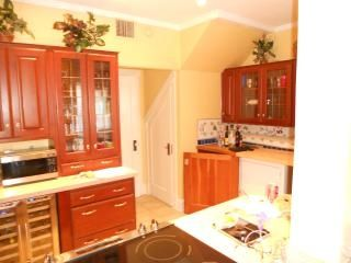 KITCHEN - New sink, silestone countertops, oven & under-counter wine cooler