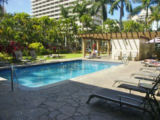 Waikiki condo photo - Tropical gardens with swimming pool, sauna and bar-b-que