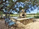 Outdoor Kitchen - A shared outdoor kitchen and dining area is also available for guest use.