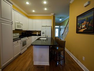 Folly Beach townhome photo - Fully-equipped kitchen has granite counter-tops and plenty of cabinet space