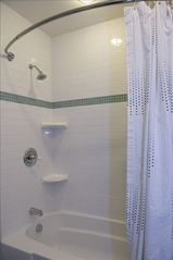 Hollywood cottage photo - Deep Soaking Tub with Shower