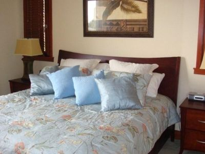 Master bedroom with luxury and plush linens, pillows and mattress.