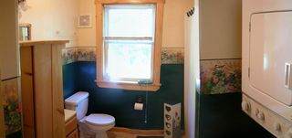 Greenville cabin photo - Panoramic view of the bathroom, bath/shower, and laundry facilities.
