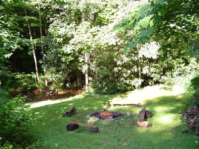 Asheville house rental - campfire site - shallow play area of the creek