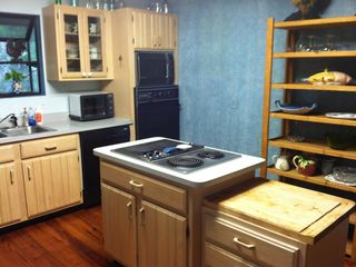 Bluffton house photo - Fully stocked kitchen with dishes, pots & pans, silverware and utensils.