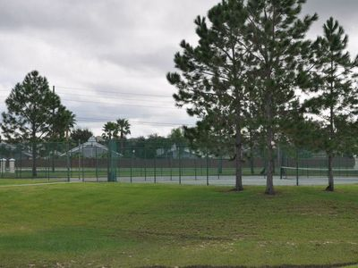 Park directly behind the house with tennis, basketball courts and playground.