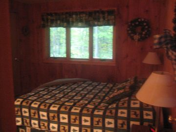 The master bedroom with queen bed and the Green Mt. Forest beyond.