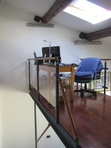 Mezzanine with writing desk and chair under roof window