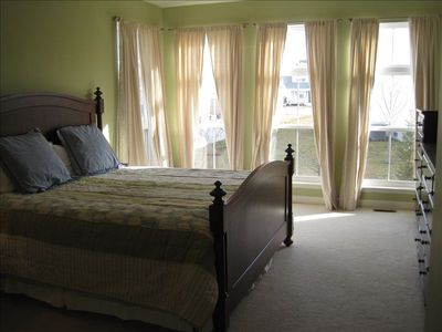 Master Bedroom: King Size Bed,  Flat Screen TV,  DVD Player, Walk-in Closet