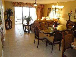 Indian Rocks Beach condo photo - New luxuriously tiled dining, living room with balcony & Gulf view