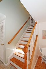 Brewster house photo - 1 of 2 stairways to 2nd floor - three more bedrooms and two full baths.