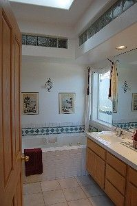 Master Bath with deep jetted tub, dual showers and sinks, steam shower, skylight