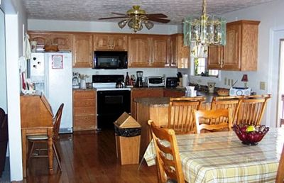Fully Equipped Kitchen with Secretary Desk and Dining Room Table