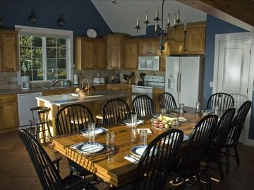 Main Level: Farmhouse table can seat twelve.