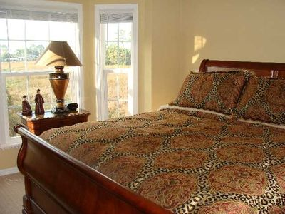 Master bed with great views and luxury linens