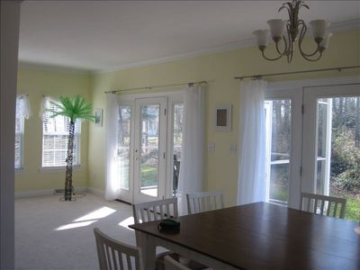 Bay Harbor house rental - Table w/seating for eight and view of the backyard & pond
