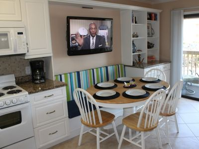 DIning area with custom bench seats six+.