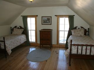 Guffey farmhouse photo - Upstairs bedroom with original wood floors (1880's) 2 singles and double bed